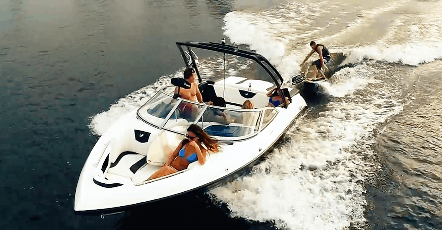 People in Wakeboard Boat on Water