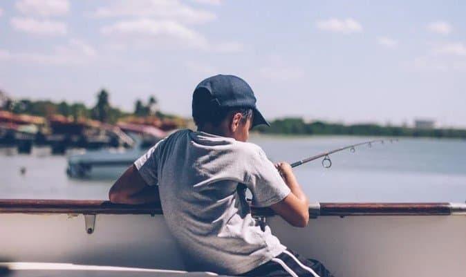 Child fishing off dock