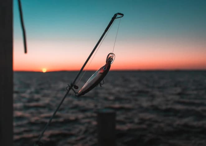 A lure on a line over the water