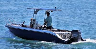 Couple in boat with trolling motor