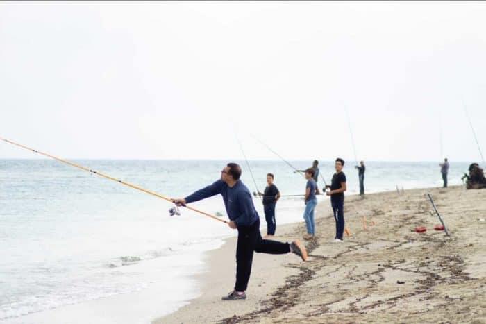 People Fishing On the Seashore