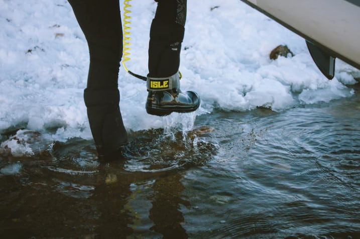 Wading through water in boots