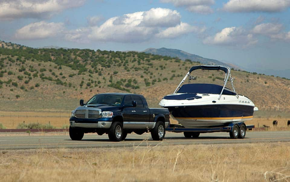 Truck towing small boat